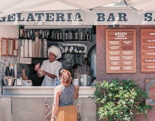 a woman ordering an ice cream at gelateria san giorgio in portofino