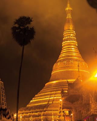 Close-up of the gleaming golden spires of Shwedagon Pagoda in Yangon