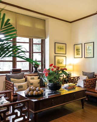 Elegant lounge area with classic colonial Burmese decor and armchair seating