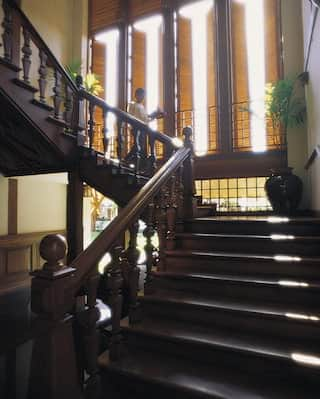 Gleaming polished hardwood staircase in the Burmese-colonial style