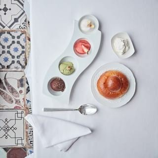 Birds-eye-view of ice cream scoops served in a curved white platter dish