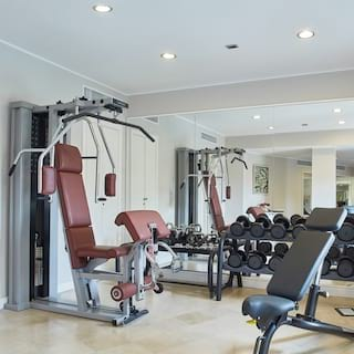 Light and airy indoor gym with a weight-rack and bench press equipment