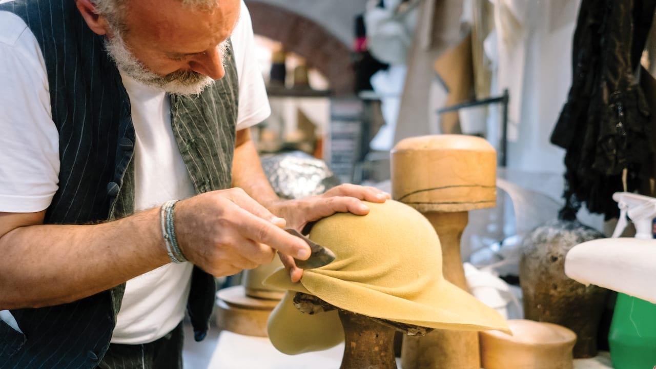 milliner creating a hat