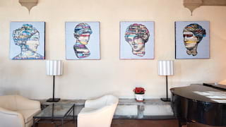 Restaurant bar area with modern canvases of famous Italian statues