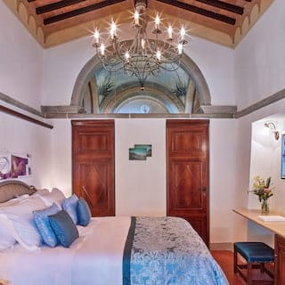 Elegant hotel room with soft king-bed and medieval and modern combined styling