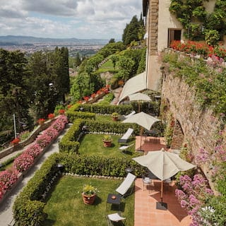 Aerial view of enclosed garden terraces with sunbeds in a row on a hilltop plateau