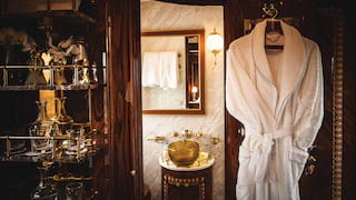 Fluffy dressing gown hanging on the door of a luxurious train cabin en-suite
