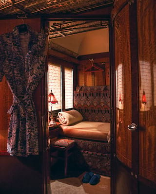 Vintage train cabin with banquette seat and hanging kimono dressing gown