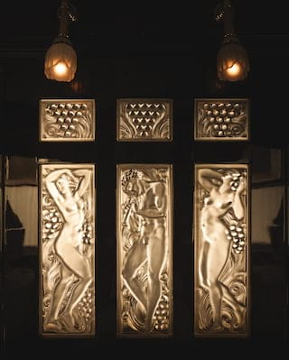 Close-up of a Lalique glass panel triptych depicting naked Grecian figures