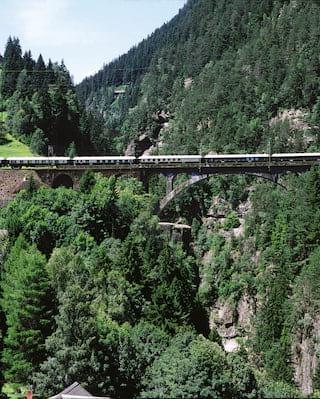 Aerial view of a train crossing a rail bridge