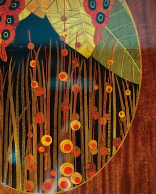 Close-up of a French-polished wooden wall panel with ornate art-deco marquetry